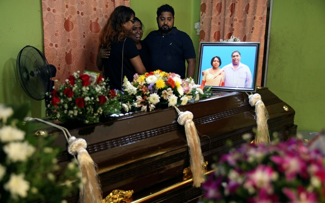 Friends and relatives mourn for Mary Noman Shanthi, 58, and Rohan Marselas Wimanna, 59, who died as bomb blasts ripped through churches and luxury hotels on Easter, in Negombo, Sri Lanka Apr 22, 2019. REUTERS