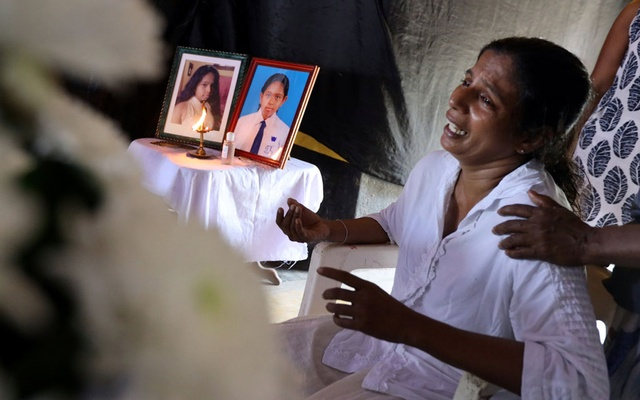 The mother of Shaini, 13, who died as bomb blasts ripped through churches and luxury hotels on Easter, mourns at her wake, in Negombo, Sri Lanka Apr 22, 2019. REUTERS