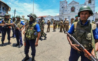 Sri Lankan soldiers guarding a church in Colombo on Sunday. Hundreds were killed and hundreds more injured in coordinated blasts at churches and hotels in the country on Easter Sunday. The New York Times