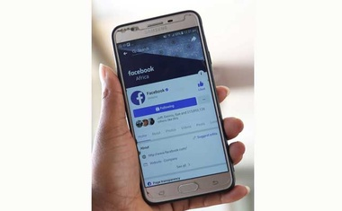 An illustration photo shows the Facebook page displayed on a mobile phone internet browser at a cyber-cafe in downtown Nairobi, Kenya Apr 18, 2019. REUTERS