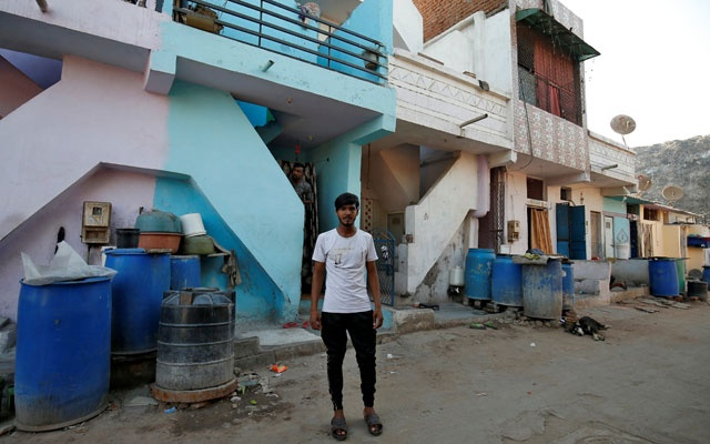 Mohammad Rafiq, 18, poses outside his house in Ahmedabad, India, Apr 12, 2019. REUTERS