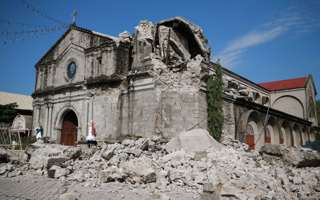 Debris and rubble surround the Santa Catalina de Alejandria Parish after an earthquake the day before in Porac town, Pampanga province, Philippines, Apr 23, 2019. REUTERS/Eloisa Lopez