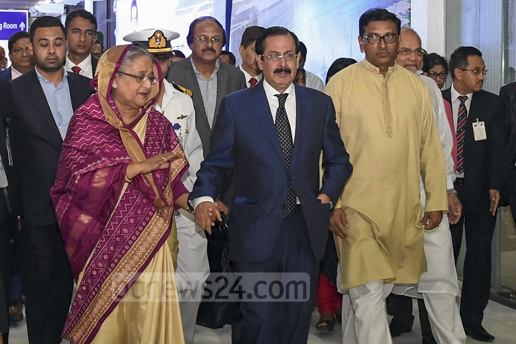Prime Minister Sheikh Hasina cries as she holds her relative Sheikh Fazlul Karim Selim, a ruling Awami League leader who lost his minor grandson in Sri Lanka bombings, at Dhaka's Shahjalal International Airport on return from Brunei on Tuesday.