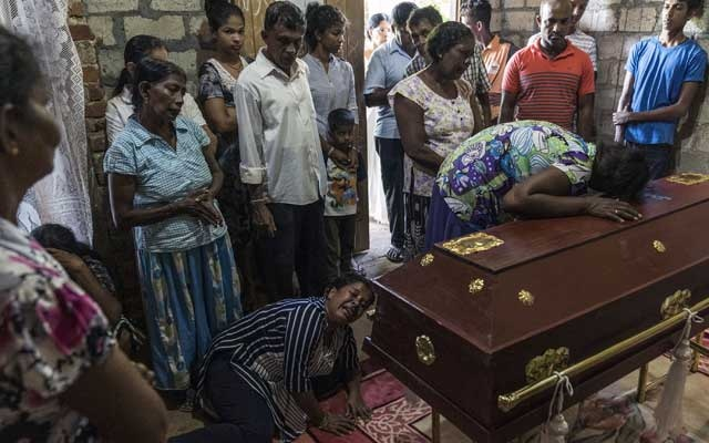 Relatives of Sneha Savindi, 11, mourn at her wake in Negombo, Sri Lanka, on Monday, Apr 22, 2019, one day after a series of devastating suicide bombings at hotels and churches on Easter Sunday that left nearly 300 people dead and more than 500 injured. Sneha was standing in line for Holy Communion on Sunday when she was killed in one of the blasts. The New York Times