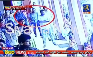 A suspected suicide bomber enters St Sebastian's Church in Negombo, Sri Lanka April 21, 2019 in this still image taken from a CCTV handout footage of Easter Sunday attacks released on April 23, 2019. CCTV/Siyatha News via REUTERS