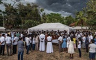 Friends and relatives at the burial of three members of one family who died in the bomb blast at St Sebastian's Church in Negombo, Sri Lanka. The New York Times