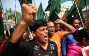 Garments workers and activists shout slogans as they take part in a rally to demand justice for the victims killed in Rana Plaza building collapse in 2013 in Savar, on the outskirt of Dhaka, Bangladesh, April 24, 2019. Reuters