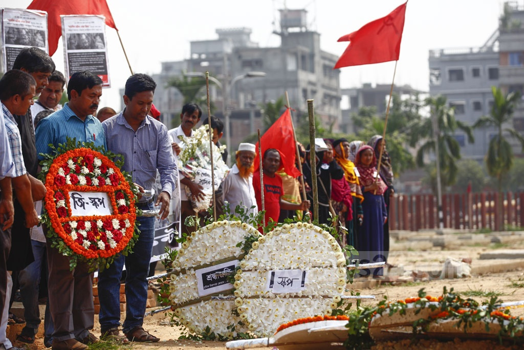 Various organisations placing floral wreaths at Jurain Graveyard in Dhaka, where most of the victims of Rana Plaza collapse were buried, on the sixth anniversary of the biggest industrial disaster in the country.