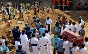 People attend the funeral of eight-month-old Mathew, who died during a string of suicide bomb attacks on churches and luxury hotels on Easter Sunday, at a cemetery in Negombo, Sri Lanka Apr 24, 2019. REUTERS