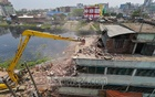 The BIWTA knocked down more than 50 structures, including two markets, built illegally on the bank of the Turag River at Tongi on the 32nd day of its ongoing drive to free the Dhaka rivers from encroachment on Wednesday.