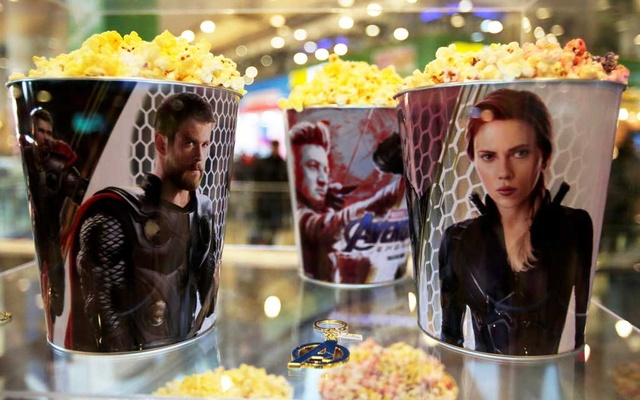 Popcorn buckets with Avengers images are seen during an early premiere of