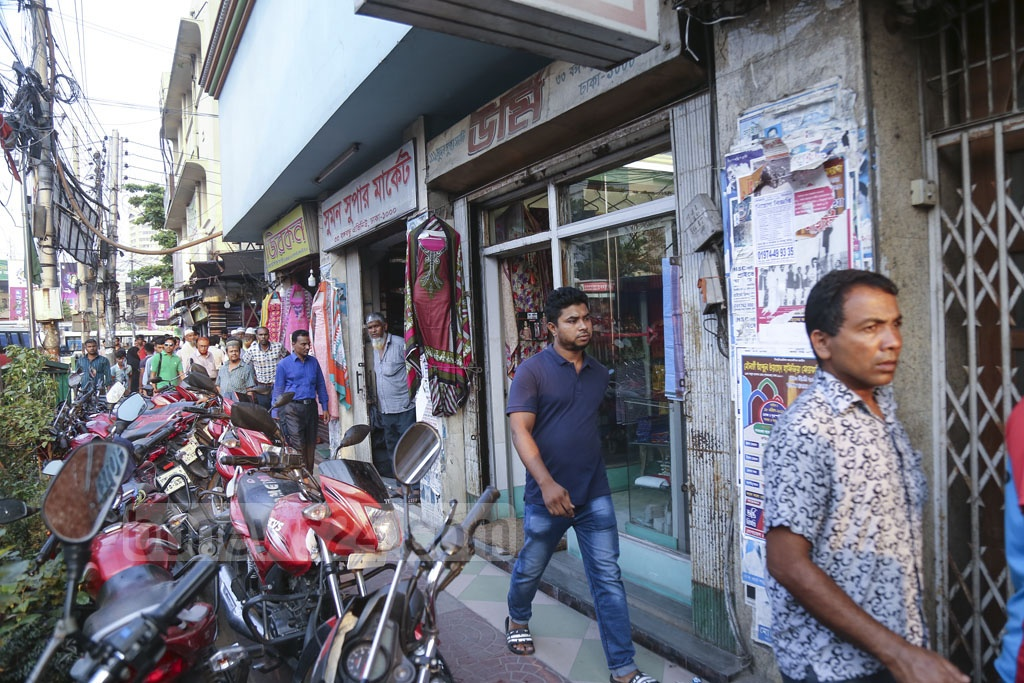 The pavements of Dhaka are often used to park motorcycles. This photo was taken from in front of the Imperial Hotel on Bangabandhu Avenue on Thursday, days after the authorities evicted hawkers from the place. Guests now park their motorcycles on the sidewalk as the hotel has no parking space. Photo: Mahmud Zaman Ovi