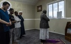 FILE — Evening prayers at the reopened Linwood mosque in Christchurch, New Zealand, where a terrorist killed 50 people, March 25, 2019. New Zealand is offering permanent residency to all of those who were at the two mosques that were attacked, as well as to the survivors' immediate relatives. (Adam Dean/The New York Times)