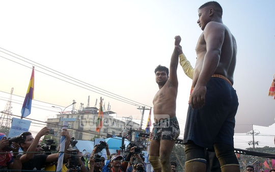 Shahjalal is declared champion of Jabbarer Bali Khela, a traditional wrestling tournament, on the Laldighi Maidan in Chattogram on Thursday. The wrestler from Cumilla beat Jibon from Chakaria of Cox's Bazar in the final match. Photo: Sumon Babu
