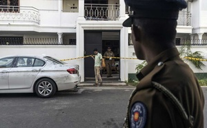 Police stand guard on Tuesday, Apr 23, 2019, outside a safe house in Colombo, Sri Lanka, that was raided and where suspects in Sunday's bombing attacks had been arrested. The New York Times
