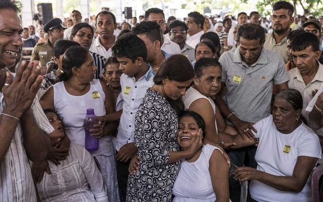 Mourners grieve at a mass funeral at St Sebastian's Church in Negombo, Sri Lanka, on Tuesday, Apr 23 2019. The New York Times