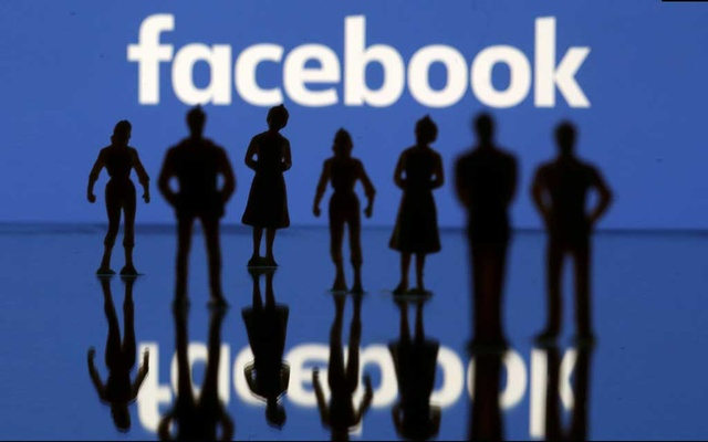 FILE PHOTO: Small toy figures are seen in front of Facebook logo in this illustration picture, April 8, 2019. REUTERS/Dado Ruvic//File Photo