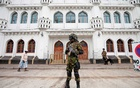 Sri Lankan Special Task Force soldiers stand guard in front of a mosque as a Muslim man walks past him during the Friday prayers at a mosque, five days after a string of suicide bomb attacks on Catholic churches and luxury hotels across the island on Easter Sunday, in Colombo, Sri Lanka April 26, 2019. REUTERS