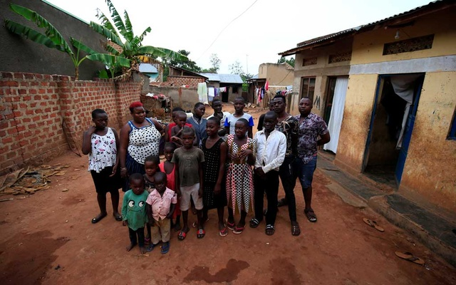 Mariam Nabatanzi, 39, (red hair) a mother of 38 children, takes a family portrait with some of her children at their home in Kasawo village, Mukono district, east of Kampala, Uganda March 8, 2019. Reuters