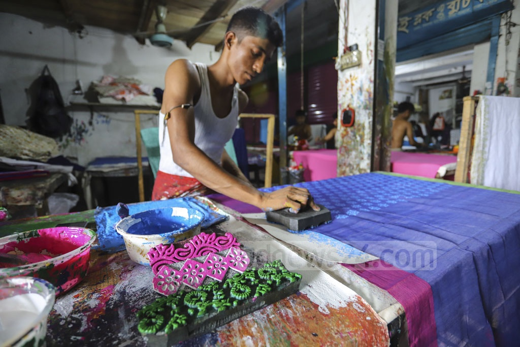 Craftsmen are spending busy time at the boutique houses ahead of the Eid-ul-Fitr. Photo: Asif Mahmud Ove
