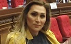 Lilit Martirosyan at the National Assembly of Armenia in Yerevan. She has received dozens of death threats since speaking there. The New York Times