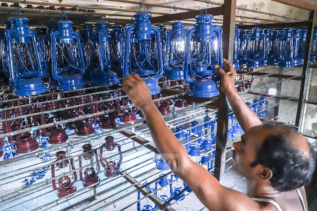 Hurricane lanterns are hung for drying after colouring at a factory in Dhaka's Kamrangirchar. Photo: Abdullah Al Momin
