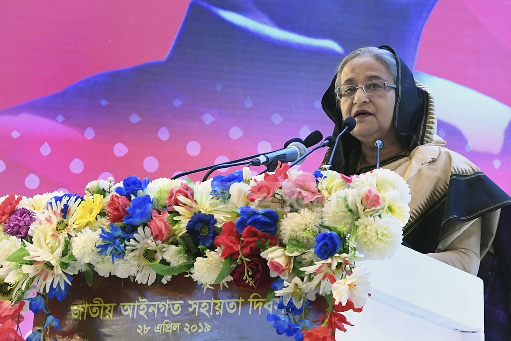 Prime Minister Sheikh Hasina addressing a programme marking the National Legal Aid Day in Dhaka on Sunday. Photo: PID