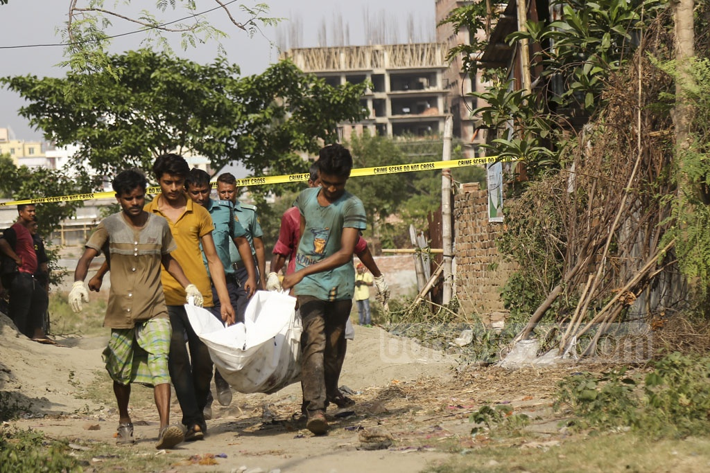 Workers carrying dead bodies of suspects after blasts during a RAB operation on a militant hideout on Road No. 8 at Metro Housing in Bosila near Mohammadpur on Monday. Photo: Mahmud Zaman Ovi