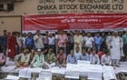 A group of investors staged a token hunger strike in front of the Dhaka Stock Exchange on Monday protesting against continuous downturn of the capital market.