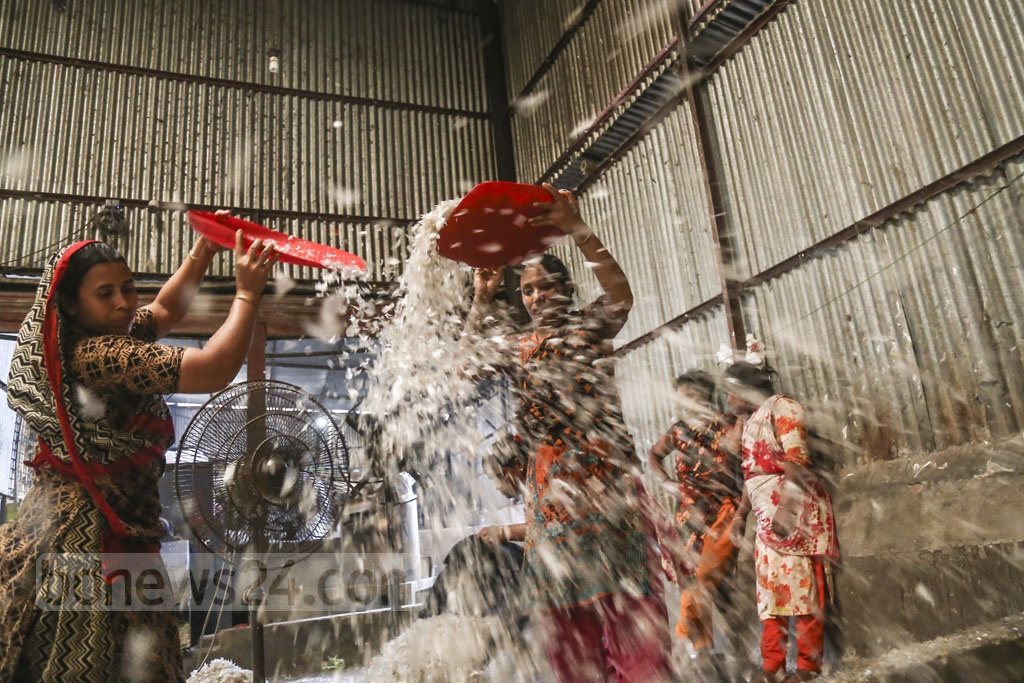 Women taking part in all sorts of work - from sorting trashed bottles to the last stage of the process - at Moonlight plastic recycling factory in Dhaka's Bhatara. Photo: Mahmud Zaman Ovi