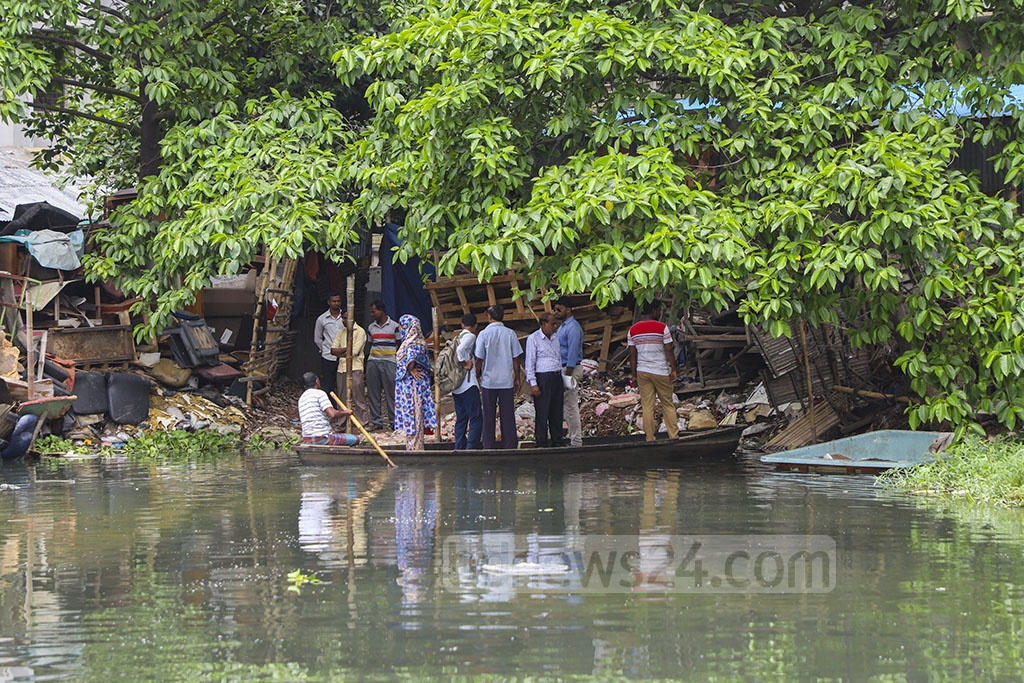 When boats are becoming rare in many parts of Bangladesh due to poor navigability and filling up of water bodies, a different picture can be seen just behind the Bangladesh Bank building in the commercial hub Motijheel in Dhaka. A boatman is still transporting people across a pond there. This picture was taken on Tuesday. Photo: Abdullah Al Momin
