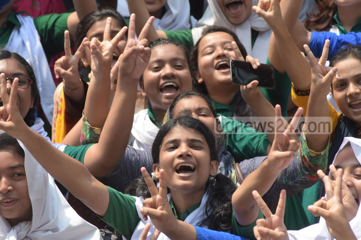 Students of Dr Khastagir Government Girls' High School, Chittagong flashing the victory sign after coming out successful in the SSC exams. Photo: Suman Babu