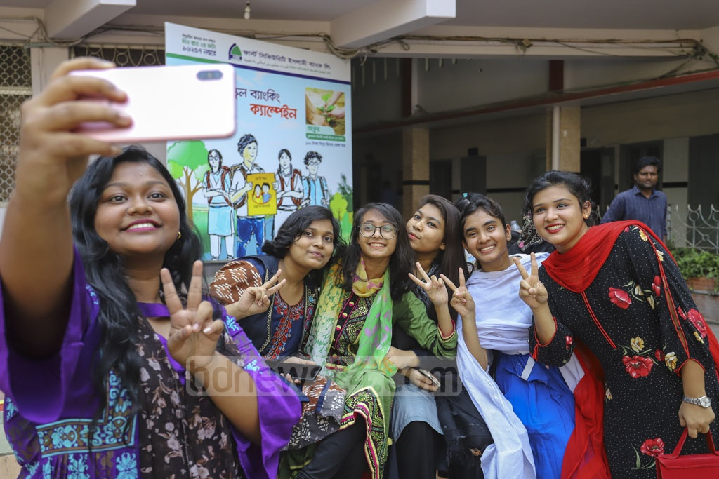 Students Motijheel Ideal School and College in Dhaka taking photos to capture the memorable moments after clearing the SSC examinations. Photo: Asif Mahmud Ove