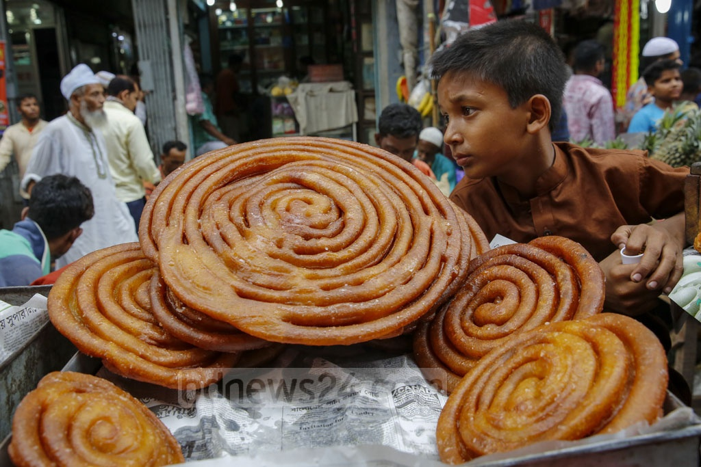 Iftar items being sold at Chawkbazar in Dhaka on the first day of Ramadan on Tuesday. Photo: Mustafigur Rahman