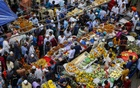 Customers buzzing in Chawkbazar Iftar shops in Dhaka on the first day of Ramadan on Tuesday. Photo: Mustafigur Rahman