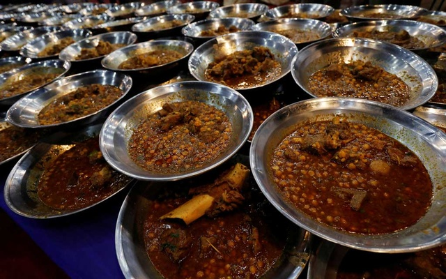Food dishes prepared with ostrich meat and chickpea are ready to serve, for the first day of the fasting month of Ramadan, in Karachi, Pakistan, May 7, 2019. Reuters