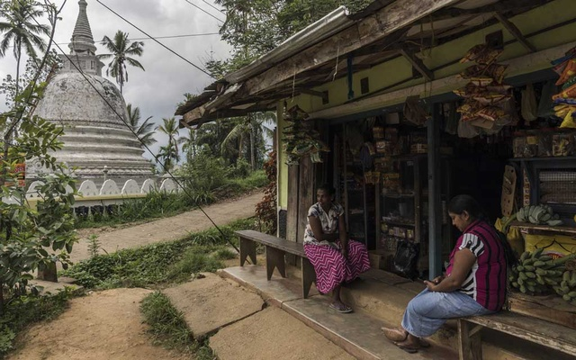 Villagers at a store situated near a Buddhist temple in Werapitiya, Sri Lanka, May 1, 2019. About 2.4 million tourists visited Sri Lanka last year, up from 500,000 in 2009, but the recent bombings have made tourists stay away. (Adam Dean/The New York Times)