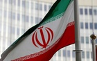 FILE PHOTO: The Iranian flag flutters in front the International Atomic Energy Agency (IAEA) headquarters in Vienna, Austria March 4, 2019. REUTERS
