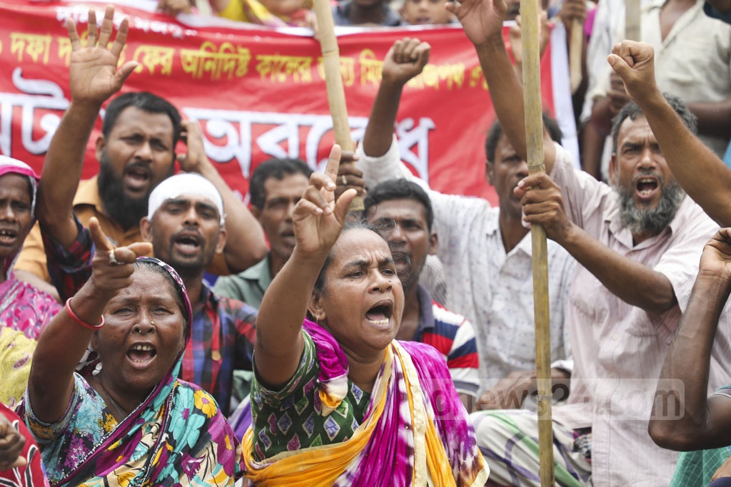 Jute mill workers blocked the street at Demra in Dhaka for the third day on Wednesday for a nine-point charter of demand, including implementation of the wage commission recommendations.