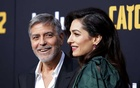 George Clooney arrives with his wife Amal at the premiere of