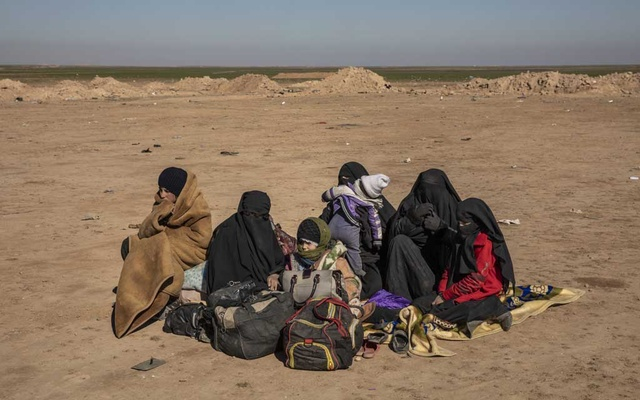 Women and children wait to be screened after escaping from the last Islamic State-held area in eastern Syria, Feb 3, 2019. With ISIS' territory down to zero, countries around the world are grappling with the dilemma of the militant group's human leftovers. The New York Times