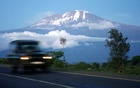 FILE PHOTO: A vehicle drives past Mount Kilimanjaro in Tanzania's Hie district December 10, 2009. Reuters