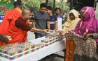 Buddhist monks distribute Iftar at the Dharmarajik Vihara in Dhaka's Sabujbagh. Photo: Asif Mahmud Ove