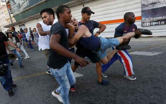 A Cuban LGBT activist is detained by plain-clothed security personnel while participating in an annual demonstration against homophobia and transphobia in Havana, Cuba May 11, 2019. REUTERS