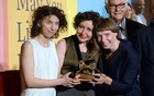 The Lithuanian artists, from left to right, Rugile Barzdziukaite, Vaiva Grainyte and Lina Lapelyte holding the Golden Lion award for best National Pavilion in Venice on Saturday. The New York Times