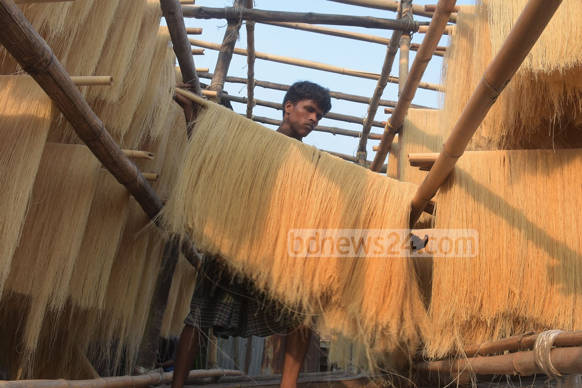 Workers drying vermicelli in Chattogram's Chaktai on Wednesday ahead of the Eid-ul-Fitr. But the process raises the question as to how much healthy the product can be. Photo: Suman Babu