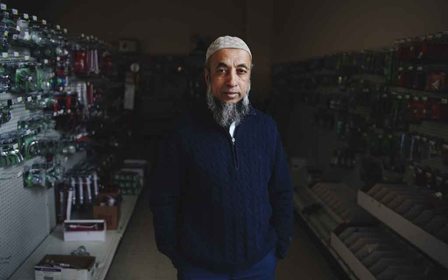 Atiqur Rahman, 56, a Bengali refugee who was one of the first in his community to move to the East Side of Buffalo in 2006, at his hardware store in Buffalo, N.Y., April 16, 2019. The Trump Administration has cut the small but steady influx of refugees into the United States, leading some cities to woo the ones who are already here. (Libby March/The New York Times)