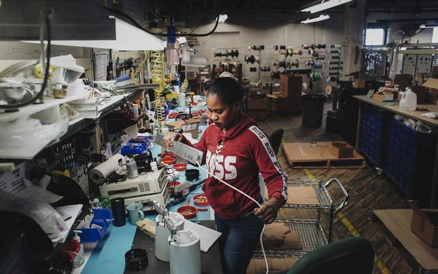 Assembling light fixtures at Litelab Corporation, where the work force is about one third immigrant employees, in Buffalo, N.Y., April 16, 2019. The Trump Administration has cut the small but steady influx of refugees into the United States, leading some cities to woo the ones who are already here. (Libby March/The New York Times)