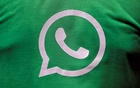 A logo of WhatsApp is pictured on a T-shirt worn by a WhatsApp-Reliance Jio representative during a drive by the two companies to educate users, on the outskirts of Kolkata, India, Oct 9, 2018. REUTERS
