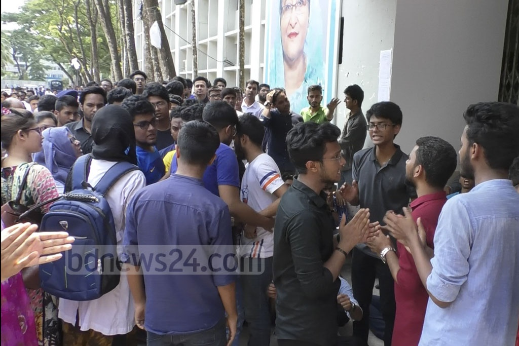 Protesters stage a sit-in at the main entrance to Myemensingh Medical College's academic building on Thursday to demand action against the alleged sexual harassment of a female student.